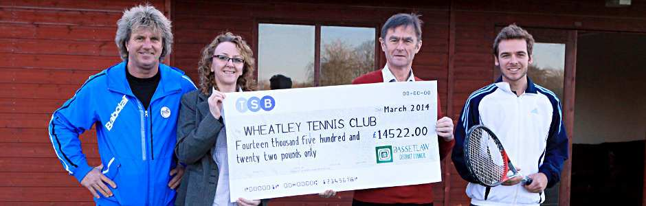 Cheque from Bassetlaw District Council being presented to Wheatley Tennis Club